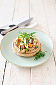 Vegan spelt pancakes with a creamy mushroom sauce, crispy smoked tofu and apple coleslaw