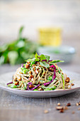 Vegan soba noodle salad with edamame, red cabbage, chilli, peanuts and a Thai basil dressing