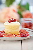 Lemon and yoghurt soufflé with rhubarb and redcurrants