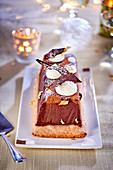 Chocolate terrine on puff pastry for Christmas