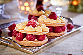 Mille feuilles with raspberries, vanilla cream and spices for Christmas