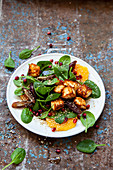 Spinach salad with tofu, oranges, dates and pomegranate seeds