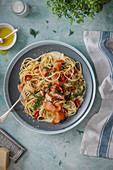 Smoked salmon pasta with creamy dill and garlic sauce, roasted cherry tomatoes and parmesan cheese