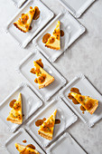Lime and coconut tart with orange passion fruit sauce, sliced