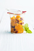Orange chutney in a preserving jar