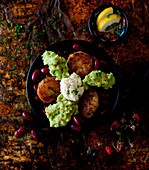 A bowl with veggie fritters, kidney beans, guacamole and cream cheese