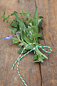 A bunch of wild herbs on a wooden background