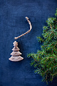 A mini carved Christmas tree decoration