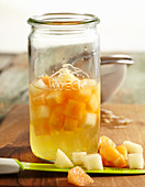 Melon preserved in gin in a preserving jar
