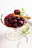 Sour cherries in syrup with lemon, cinnamon and mint