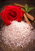 Homemade oriental rose and cinnamon salt with fresh rose petals and mint