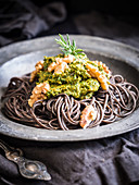 Gluten-free black bean pasta with vegan spinach and sun-dried-tomato pesto