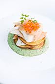 Smoked trout with caviar on crispy potato slices
