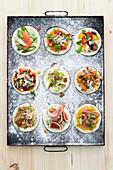 Various unbaked mini pizzas