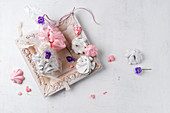 Meringues with violets as a gift