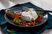 Burrata with a tomato and olive salad (Italy)