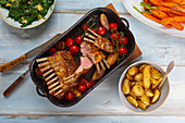 Rack of lamb with cherry tomatoes and fried potatoes