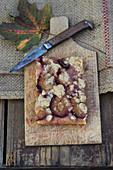 Zwetschgendatschi (plum crumble cake from Bavaria) on a wooden board