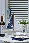 Maritime accessories and white wine on table