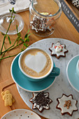 Cup of coffee and gingerbreads