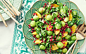 Brussels sprouts salad with orange and pomegranate seeds
