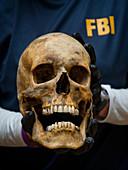 ERT Member Holding Skull, 2012