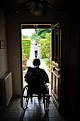 Elderly person in a wheelchair