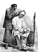 Chinese barber in Peking, 1860s