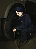 WWII, Woman Checks Tank Tires, 1943