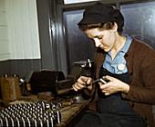 WWII, Woman Filing Gun Parts, 1943