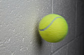 Tennis Ball About to Collide with a Wall