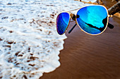 Beach reflected in a pair of sunglasses, Hawaii