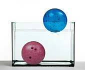 Plastic Ball and Bowling Ball in Water