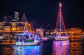 Nighttime Christmas Boat Parade in Huntington Beach, CA
