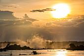 Steam rising from the Zambezi River at sunset, Livingstone,