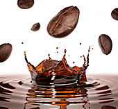 Coffee beans falling into pool of coffee, illustration