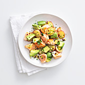 Salmon and avocado salad with potatoes and pistachio nuts