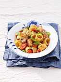 Calamarata pasta with tuna fish, tomatoes and basil
