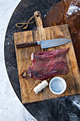 A winter barbecue: elk steak being prepared for a barbecue (Norway)