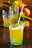 Mineral water with homemade orange syrup as a refreshing drink