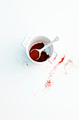 Paprika powder in a cup with a spoon