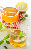 Lemon balm syrup with mineral water and lemon