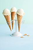 Vanilla ice cream in cones in a cone holder