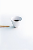 Soy sauce in a small bowl