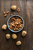 Walnuts and almonds in a ceramic bowl