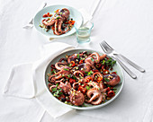 Fried squid with caramelised, oven-roasted tomatoes and crispy breadcrumbs
