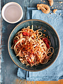 Spaghettoni with a shallot sauce and taralli crumbs