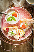 Simple and light sponge cake with fresh strawberries served with cream and mint
