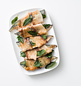 Grilled mackerel fillets with sage wrapped in bacon