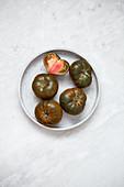 Organic Tomato 'Marmande black' on marble backgroun